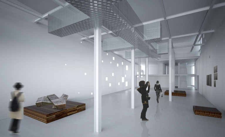 AQSO arquitectos office. The exhibition hall of the Boilerhouse cultural centre occupies the boiler room of the old building. The interior is a neutral space finished in white with small windows.