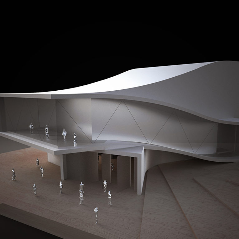AQSO arquitectos office. Model of the auditorium with the curved roof. It is made of wood and aluminium, with a futuristic and organic design.