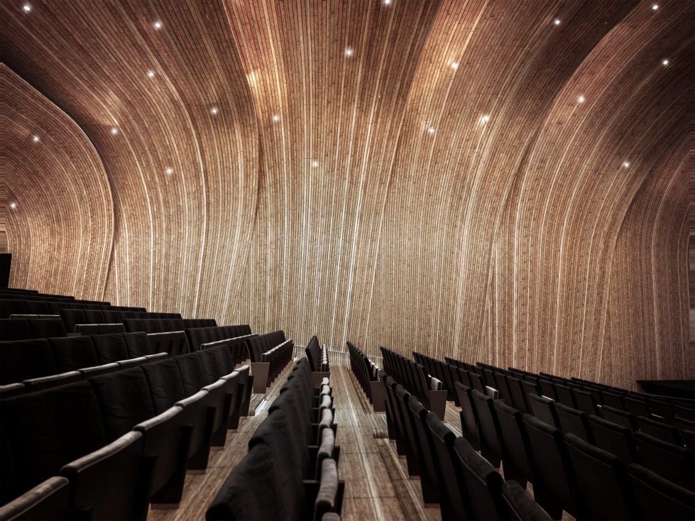 aqso arquitectos office, folded auditorium, black seating, side view, wrapping timber system, acoustic walls, wooden shell, overlapping planes, amazing design