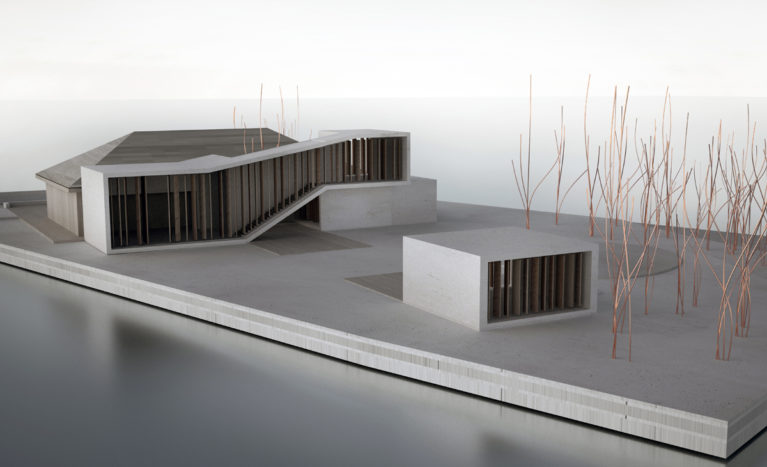 AQSO arqutiectos office. Cardboard model showing the original house and the extension. The wooden slatted façade stands out in this modern and simple design.