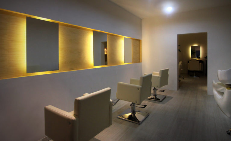 AQSO arquitectos office. Hair salon, interior design, minimalistic, lighting feature, backlighted mirror, timber veneered, concrete floor, simple design, clean space, neat form