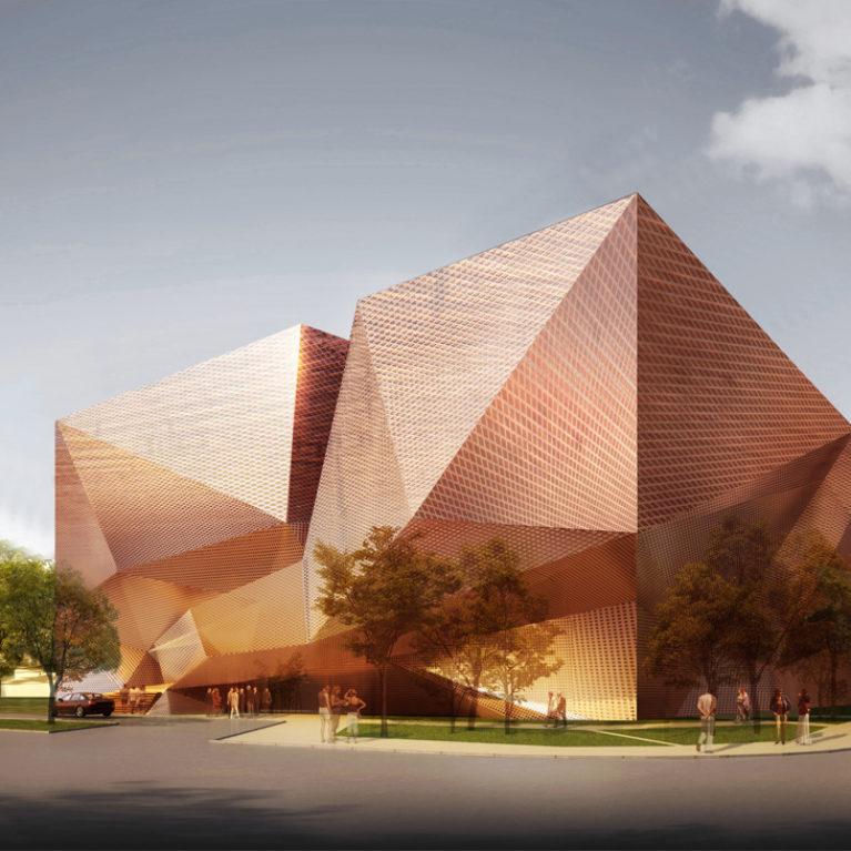 AQSO arquitectos office. El museo se sitúa en un parque urbano con abundante vegetación. La forma del edificio es sencilla, una sobria caja, envuelta en una fachada semitransparente de formas angulosas de metal brillante.