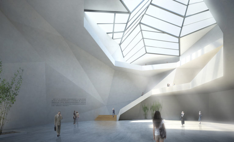 AQSO arquitectos office. The central atrium of the building is a space illuminated by a large skylight. The plasticity of its concrete walls reminds us of a natural cave dominated by the stairs leading to the upper level.