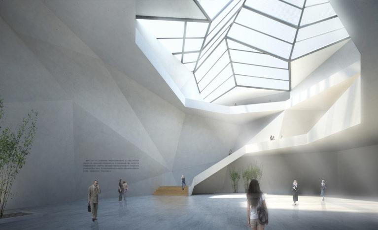 AQSO arquitectos office. El atrio central del edificio es un espacio iluminado por un gran lucernario. La plasticidad de sus muros de hormigón nos recuerda a una cueva natural dominada por las escaleras de acceso al nivel superior.