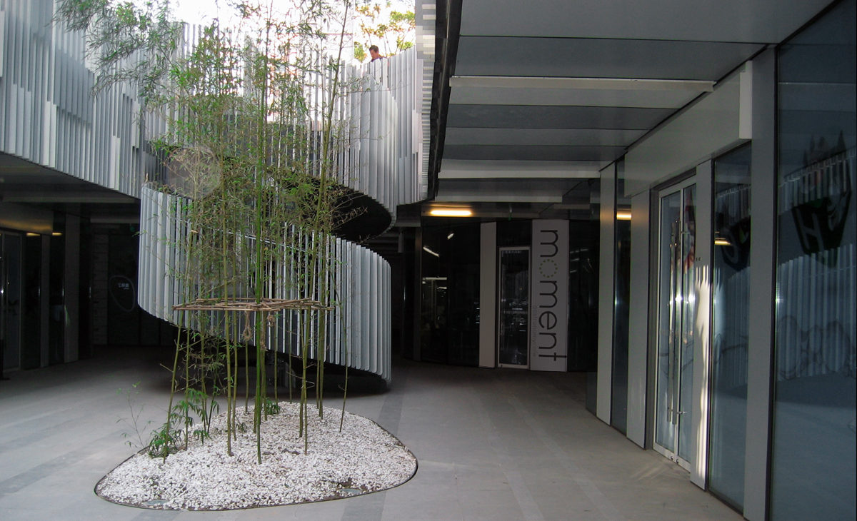 AQSO moment cafe, outdoor courtyard, spiral staircase