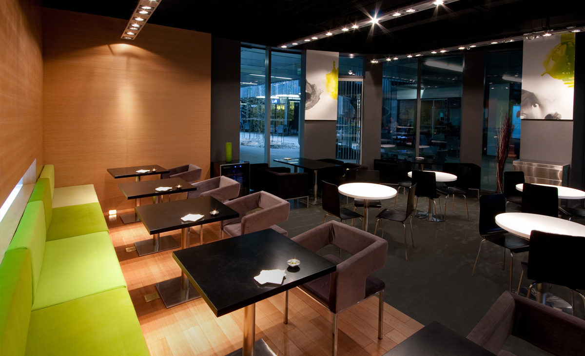 AQSO moment cafe, interior design, sitting area, custom furniture, polish concrete, wooden walls