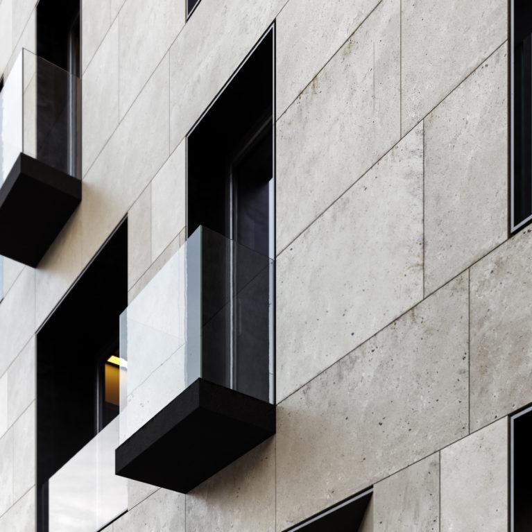 AQSO arquitectos office. Detalle de uno de los balcones. Un simple forjado cubierto con un forro de metal oscuro sobresale del plano de fachada y se cierra con una barandilla de cristal sin marco, contrastando con el aplacado de piedra arenisca.