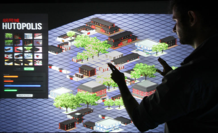 AQSO arquitectos office. A large touch screen allows visitors to the exhibition to interact with the urban parameters of the Hutong and to understand the balance and diversity of the neighbourhood.