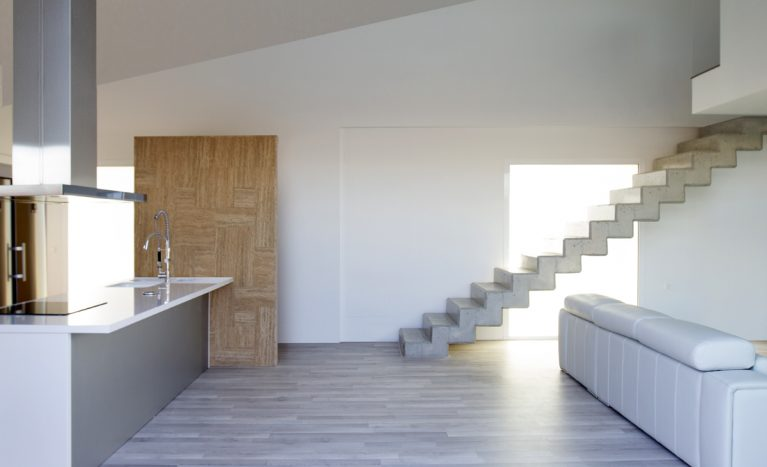 american-kitchen, aqso, casa-cuna, counter, exposed-concrete, folded-slab, grey-wood, interior, kitchen-hood, stainless-steel, stair, staircase, travertine, wall, white-color, wooden-floor