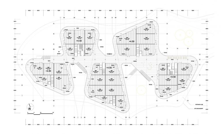 AQSO arquitectos office. The circulation system of the shopping centre is based on a main axis linking the five volumes of the building and a series of ring-shaped corridors around it.