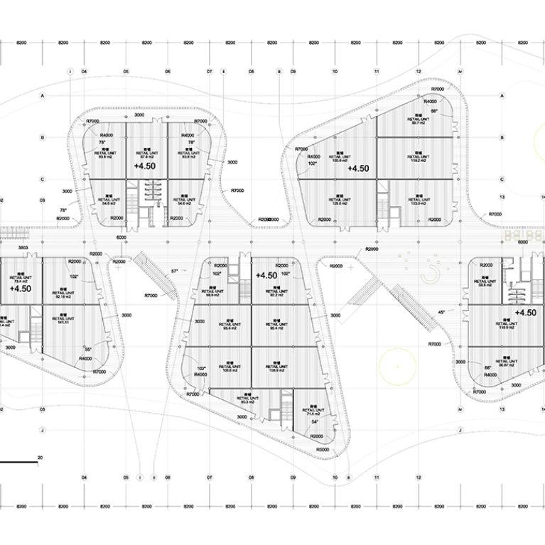 AQSO arquitectos office. El sistema de circulación del centro comercial se basa en un eje principal que une los cinco volúmenes del edificio y una serie de corredores en forma de anillo a su alrededor.