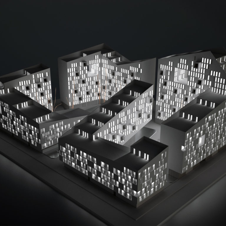 AQSO arquitectos office. Back-lighted architectural model of the residential complex where the zig-zag volume, the terraces and the courtyards can be appreciated.
