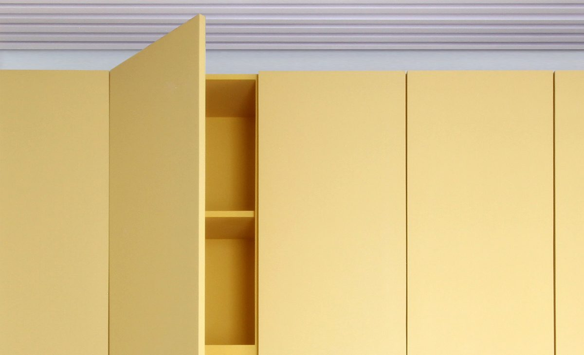AQSO Ivy foundation, lacquered furniture detail, yellow door, cabinet