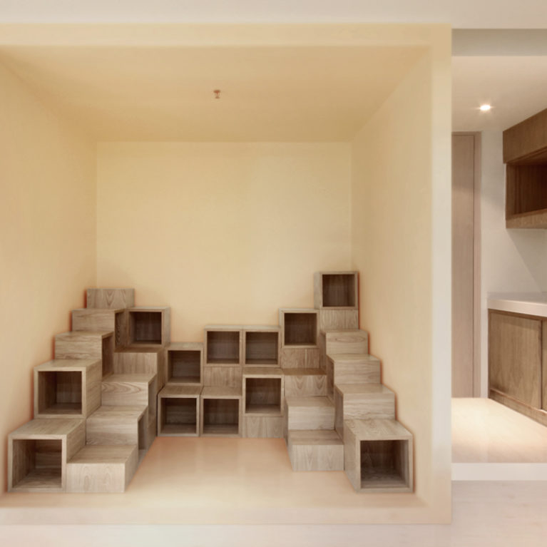 AQSO arquitectos office. Near the waiting room there is a reading corner for children. This children's library consists of modular cubes where children can sit.
