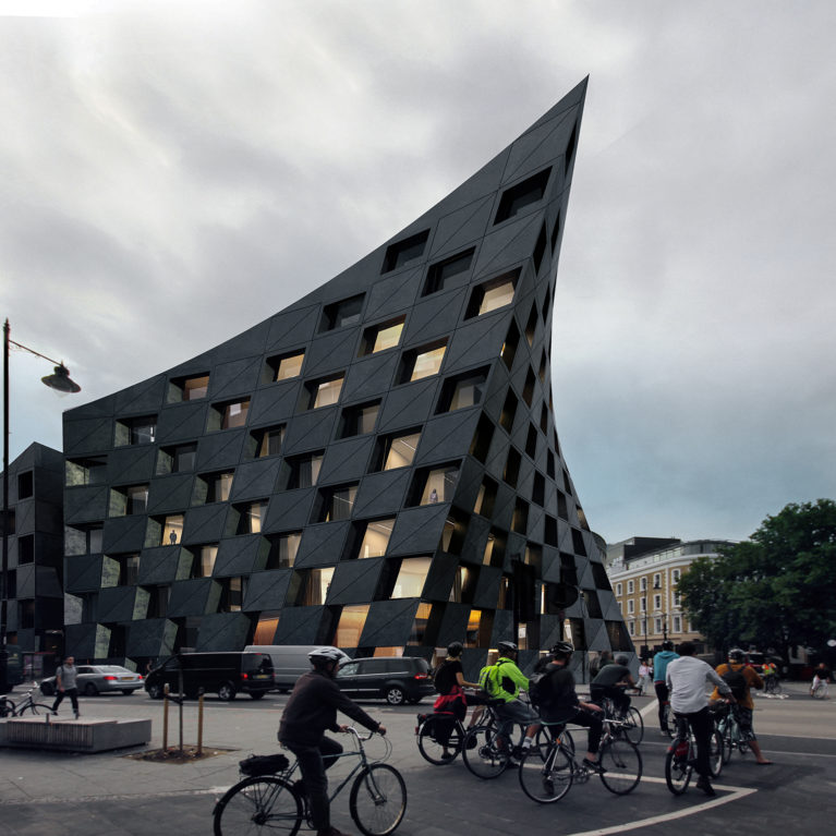 AQSO arquitectos office. The parametric façade seen from the street offers the dynamic and changing image of a curved black concrete building.