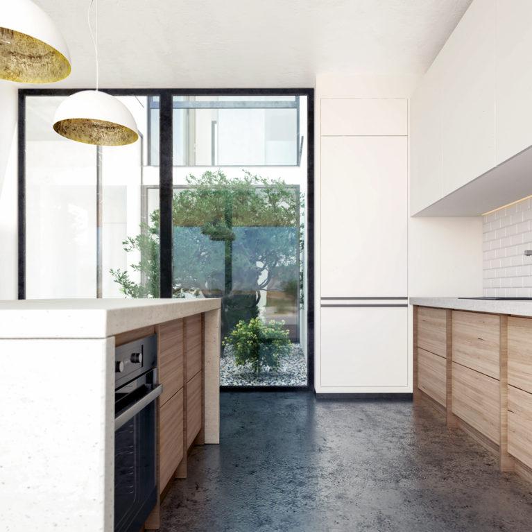 aqso arquitectos office, cocina con patio, azulejos de metro, encimera de hormigón, cocina con isla, suelo de hormigón pulido, madera de roble, diseño funcional, mobiliario de cocina, espacio luminoso