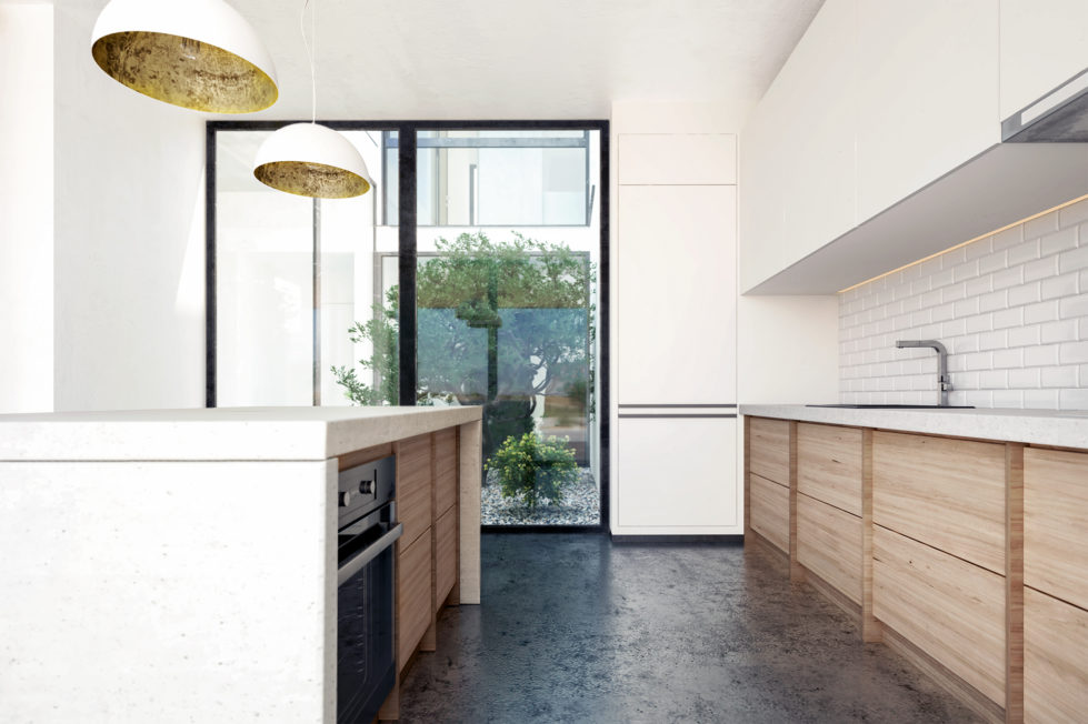 aqso arquitectos office, courtyard kitchen, metro tiles, concrete counter, kitchen island, concrete floor, oak timber, funtional design, kitchen cabinets, bright space