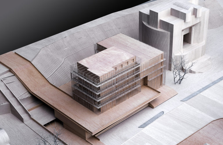 aqso arquitectos office. Wooden physical model of the new extension and facade. The promenade for pedestrians becomes a new entrance point. The model is made of timber and metal.