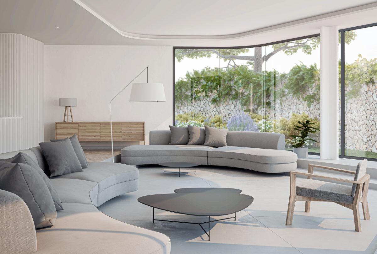 AQSO arquitectos office. La sala de estar, rehundida un escalón, forma un espacio acogedor y cómodo. El mobiliario moderno y funcional crea una atmósfera cálida y relajada.