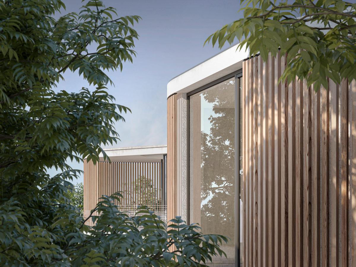 AQSO arquitectos office. La singular fachada de la vivienda se percibe a través de los árboles de la parcela. Los listones de madera encierran el balcón para dar privacidad al dormitorio principal.
