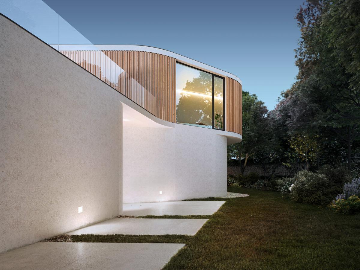 AQSO arquitectos office. El acceso a la casa K es un paseo por la naturaleza. Le entrada es un gesto de bienvenida expresado a través de la plasticidad de sus muros curvos.