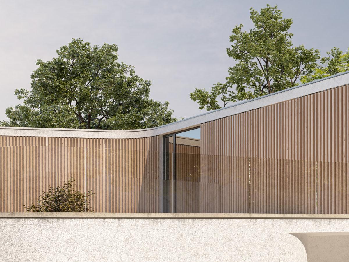 AQSO arquitectos office. Fachada curva de listones de madera, con vegetación al fondo.
