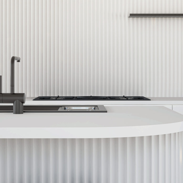 AQSO arquitectos office. Detail of the kitchen island, with vertical ceramic tile walls and minimalist matt black mixer tap.