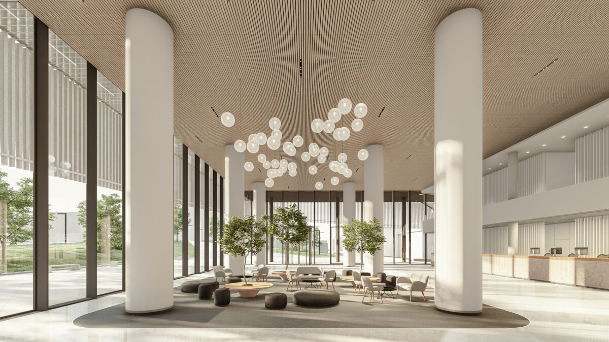AQSO arquitectos office. The hospital entrance lobby is a generous double height space enclosed by a curtain wall, it counts with a seating area and a reception counter.