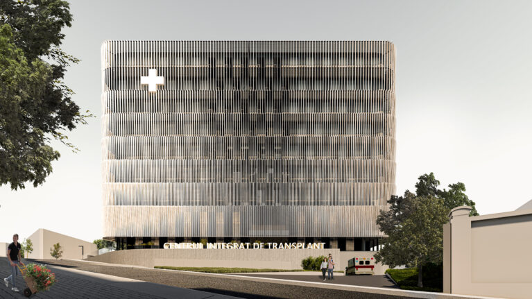 AQSO arquitectos office. The transplant centre is a modern building, compact in shape and with a functional arrangement. The minimalist aesthetic of the exterior resembles an institutional public building.