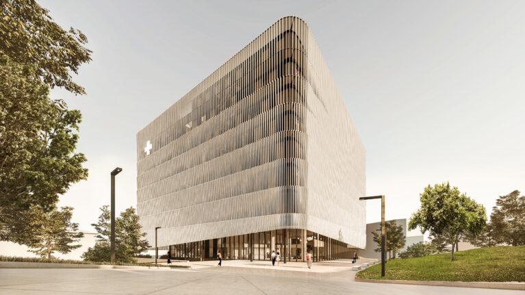 AQSO arquitectos office. Desde la nueva plaza pública el edificio abre su piel en el nivel inferior para dar acceso a través de la planta baja.