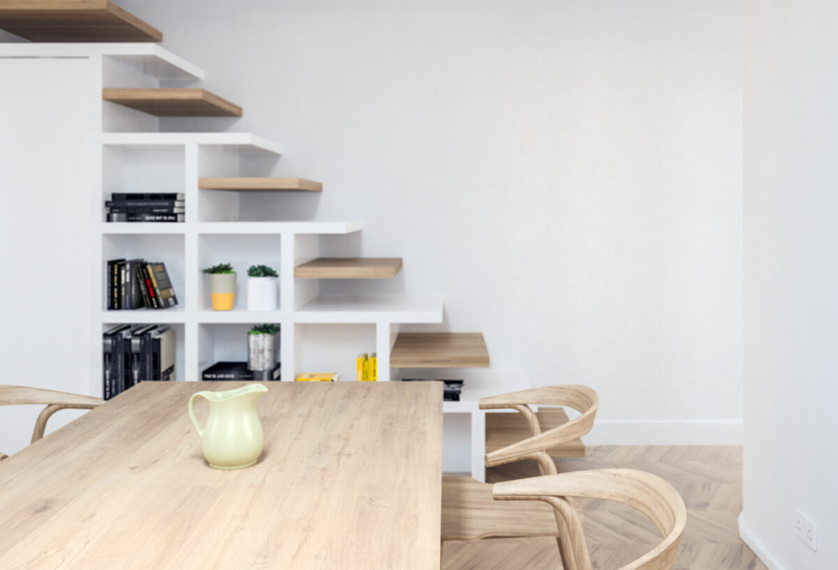 AQSO arquitectos office. The unique design of the stairs provides a bookcase in front of the dining room and conceals a small toilet under the steps.