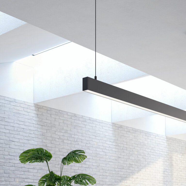 AQSO arquitectos office. The skylight in the living room is achieved by opening up the space between the beams supporting the upper floor. The openings are flared to let in more light.