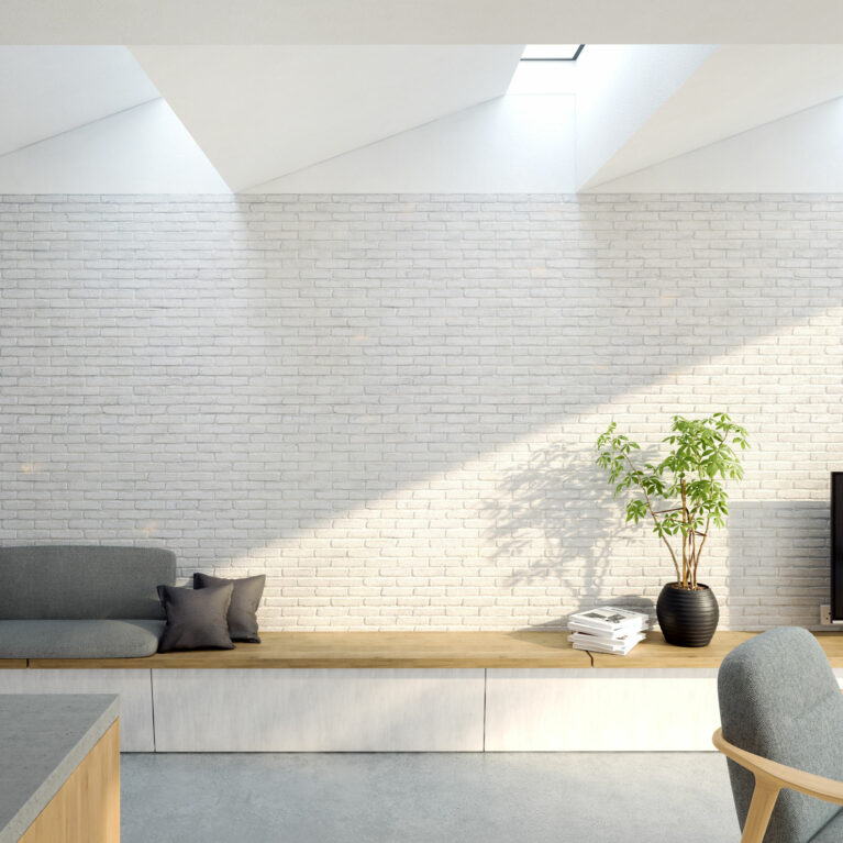 AQSO arquitectos office. Along the white-painted solid brick wall sits a comfortable, informal wooden bench that doubles as a sofa and sideboard.