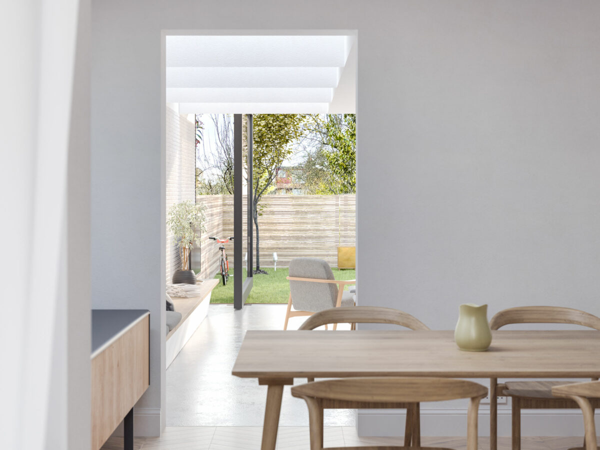 AQSO arquitectos office. From the dining room you can see the back garden of the house, separated by the threshold of the door. The open floor plan allows a visual connection between all the spaces.