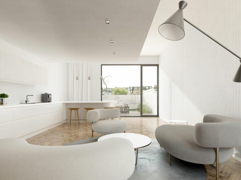 AQSO arquitectos office. The living room with the Ela sofas by Piet Boon and the peninsula in the background is a bright and simple space with views of the back garden.