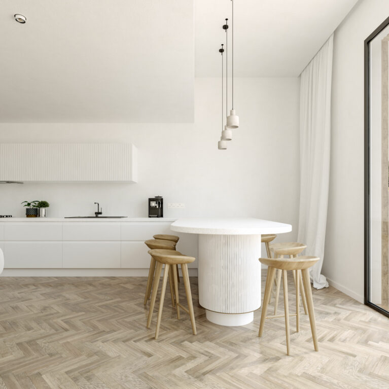 AQSO arquitectos office. The matt white kitchen units add brightness. The worktop ends in a peninsula with stools that serves as a dining table.